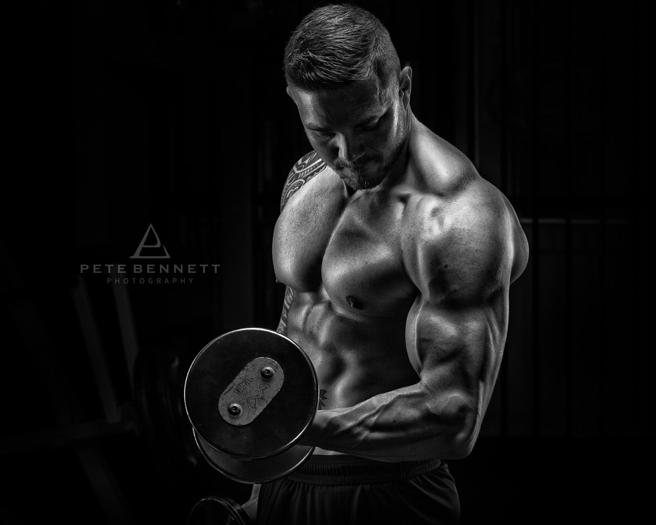 Black and white image of dean dark body building photoshoot