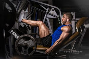 gym shoot leg press fitness professional photography